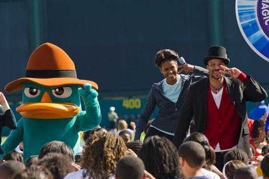 Obama moves with Phineas and Ferb character Perry the Platypus.