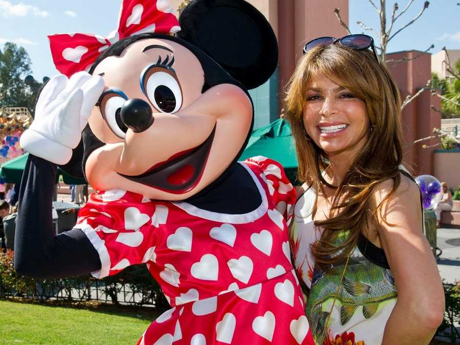 "Entertainer Paula Abdul poses with Minnie Mouse Feb. 14, 2012 at Disney's Hollywood Studios park at Walt Disney World Resort in Lake Buena Vista, Fla.  For the day, Minnie Mouse wore her special ""Valentine's Day"" dress, with white hearts replacing her usual white polka dots."
