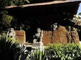 That statue is located right outside Expedition Everest in the Asia area of Disney's Animal Kingdom theme park.