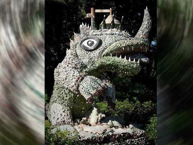 "If you guessed the dinosaur sculpture at the Dinoland U.S.A. area of Disney's Animal Kingdom park then you are right! Called the ""Party 'O Saurus,"" it was sculpted by a folk artist known as Mr. Imagination. Look close, there's a special pin embedded in the sculpture."