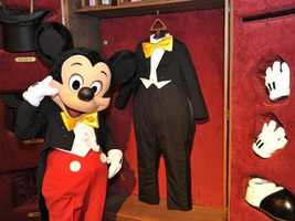 Mickey gives a peek at his traveling clothes trunk, complete with top hats, gloves and a magic wand.