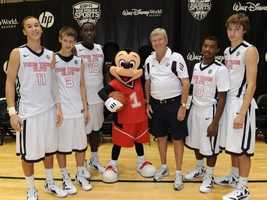The Texas Elite basketball team takes a timeout from a game of hoops with Mr. Mouse.