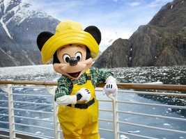 Mickey sports some yellow rubber overalls and a plaid shirt on an Alaskan cruise.