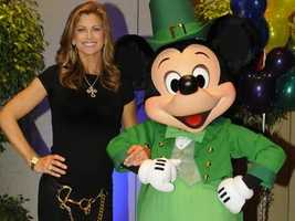Mickey, wearing a green tuxedo and top hat, while he parties with Kathy Ireland on St. Patrick's Day.