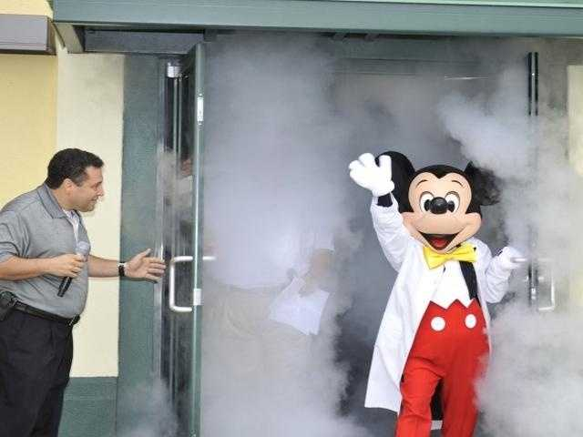 What does Mickey Mouse where while he's imagineering inside Disney's innovation studio? A lab coat, of course.