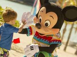 He can do casual, too. Mickey sports a colorful swimsuit while hanging out on the beach.