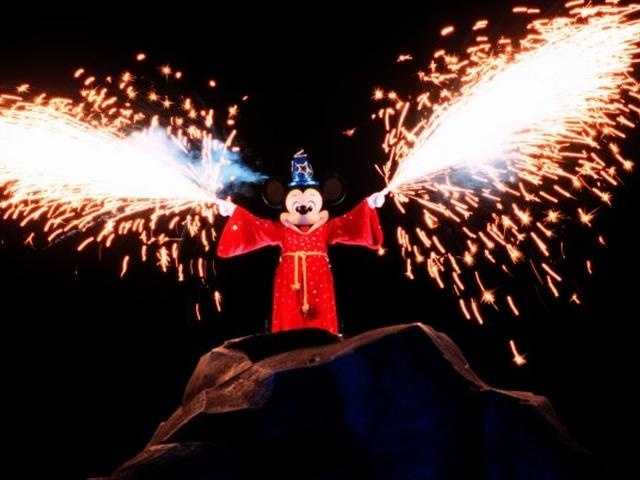 Not everyone can pull off fireworks as a fashion accessory, but Mickey Mouse can. He looks pretty magic in his sorcerer outfit.