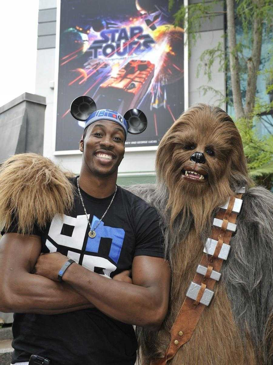 Orlando's own Magic superstar Dwight Howard meets Chewbacca outside the remodeled Star Tours attraction at Disney's Hollywood studio.