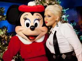Christina Aguilera poses with Minnie Mouse following the taping of the 2011 Disney Parks Christmas Day Parade at Disney's Grand Californian Hotel & Spa in Anaheim, Calif., on Sunday, Dec. 5.