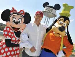 Actor Bruce Willis poses with Minnie Mouse and Goofy Feb. 27, 2011 during a visit to Disney's Hollywood Studios theme park in Lake Buena Vista, Fla.