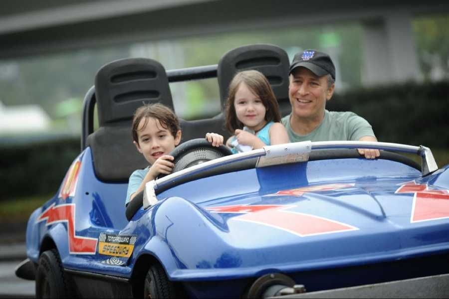 Emmy Award-winning TV host and Grammy Award-winning comedian Jon Stewart takes a ride Feb. 4, 2011 on the Tomorrowland Indy Speedway at the Magic Kingdom theme park in Lake Buena Vista, Fla. with his children Nate (left, age 6) and Maggie (center, age 5). The Feb. 4 visit took place on Maggie's 5th birthday, and Stewart and his family celebrated the occasion with friends at the Walt Disney World theme park