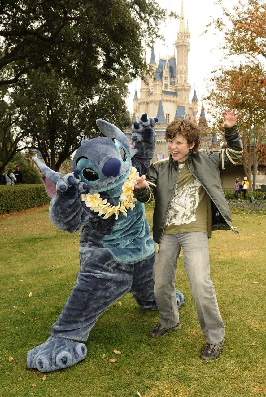 "Nolan Gould, the 12-year-old actor from the hit ABC-TV series ""Modern Family,"" poses Dec. 19, 2010 with Stitch from Disney's ""Lilo and Stitch"" at the Magic Kingdom in Lake Buena Vista, Fla."