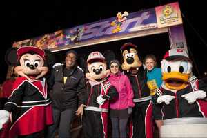 'Today Show' hosts Al Roker, Meredith Vieira and Natalie Morales pose Jan. 8, 2011 with Disney characters at the start line for the Walt Disney World Half Marathon in Lake Buena Vista, Fla. The trio ran in the annual 13.1-mile race.