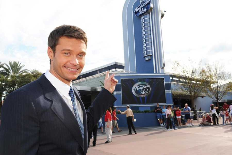 TV and radio personality Ryan Seacrest poses in front of The American Idol Experience attraction at Disney's Hollywood Studios in Lake Buena Vista, Fla.
