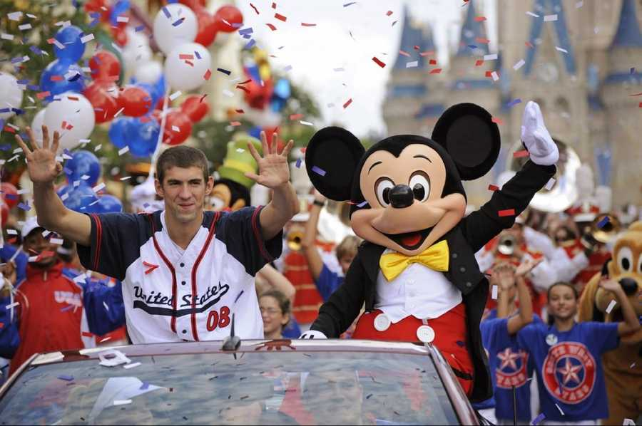 "Michael Phelps waves to fans Aug. 29, 2008 at the Magic Kingdom in Lake Buena Vista, Fla. during a ""Homecoming Parade"" in his honor."
