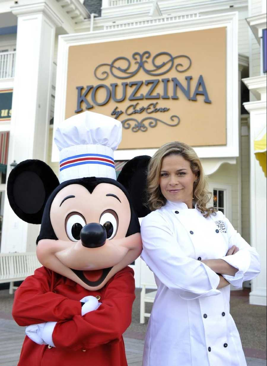 "Celebrity chef Cat Cora poses Sept. 17, 2009 with a chef-attired Mickey Mouse during the grand opening of her first signature restaurant, ""Kouzzina by Cat Cora,"" located at Disney's BoardWalk at Walt Disney World in Lake Buena Vista, Fla."