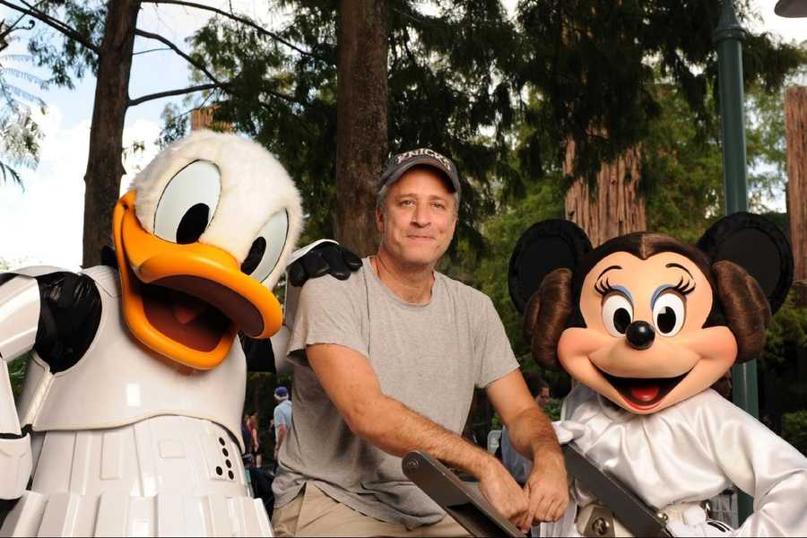 """""""The Daily Show"""" host Jon Stewart poses Aug. 14, 2010 at Disney's Hollywood Studios in Lake Buena Vista, Fla. with """"Star Wars""""-inspired Disney characters Stormtrooper Donald Duck and Princess Leia Minnie Mouse. Stewart was in Orlando as a special host of """"Star Wars Celebration V,"""" the official Lucasfilm fan event held at the Orange County Convention Center."""