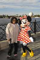 "Emmy, Grammy, Tony, Golden Globe, NAACP Image and Academy award-winning actress and TV personality Whoopi Goldberg poses Dec. 19, 2009 with Minnie Mouse at Epcot. Goldberg, also a co-host on ABC's ""The View,"" was at Epcot to be the featured celebrity narrator in the Candlelight Processional."
