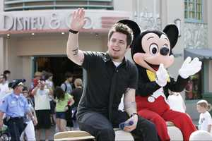 """American Idol"" Lee DeWyze takes a celebratory ride May 31, 2010 with Mickey Mouse through Disney's Hollywood Studios theme park in Lake Buena Vista, Fla. Following his win on the ""American Idol"" season finale last week in Los Angeles, DeWyze looked into TV cameras and shouted ""I'm Going to Disney World!"""