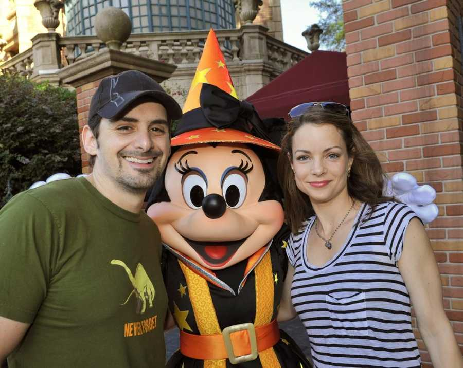"Country music artist Brad Paisley and his wife, actress Kimberly Williams-Paisley (""Father of the Bride,"" ""According to Jim""), pose Oct. 25, 2010 with a Halloween-clad Minnie Mouse in front of the Haunted Mansion at the Magic Kingdom in Lake Buena Vista, Fla. The singer and his wife also were celebrating Brad's October 28th birthday at Walt Disney World this week."