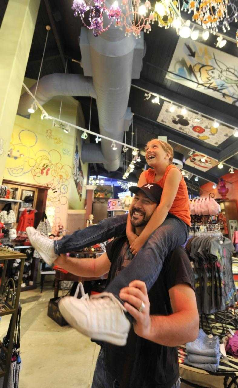 "Television and music personality Joey Fatone carries his daughter Briahna, April 10, 2009 through the ""Tren-D"" store at Walt Disney World Resort in Lake Buena Vista, Fla. during Grand Opening festivities for the new fashion boutique."