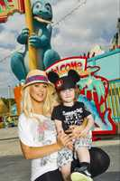 "Grammy Award-winning singer Christina Aguilera poses with her son Max April 11, 2011 in Disney's Animal Kingdom theme park at Walt Disney World Resort in Lake Buena Vista, Fla.  In the early 1990s, Aguilera starred on ""The New Mickey Mouse Club,"" a musical variety series taped at Walt Disney World.  On April 26, 2011, Aguilera will debut as one of four musician coaches on the new NBC vocal competition series ""The Voice."""