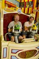 "Actor Jesse Tyler Ferguson (left) joins Justin Mikita (right) March 24, 2011 for a ride aboard ""Toy Story Mania!"" at Disney's Hollywood Studios in Lake Buena Vista, Fla. Ferguson portrays ""Mitchell"" on the TV series ""Modern Family."" Ferguson and Mikita are on vacation at the Walt Disney World Resort."