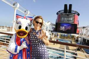 "Actress and new ""Celebrity Apprentice"" contestant Marlee Matlin gets acquainted with Daisy Duck aboard the new ""Disney Dream"" cruise ship during its christening ceremony Jan. 19, 2011."