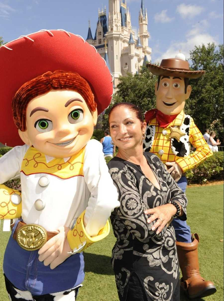 "Grammy Award-winning singer Gloria Estefan poses June 26, 2010 with her new pals from the silver screen -- ""Toy Story 3"" characters Jessie (left) and Woody (right) -- at the Magic Kingdom park in Lake Buena Vista, Fla."