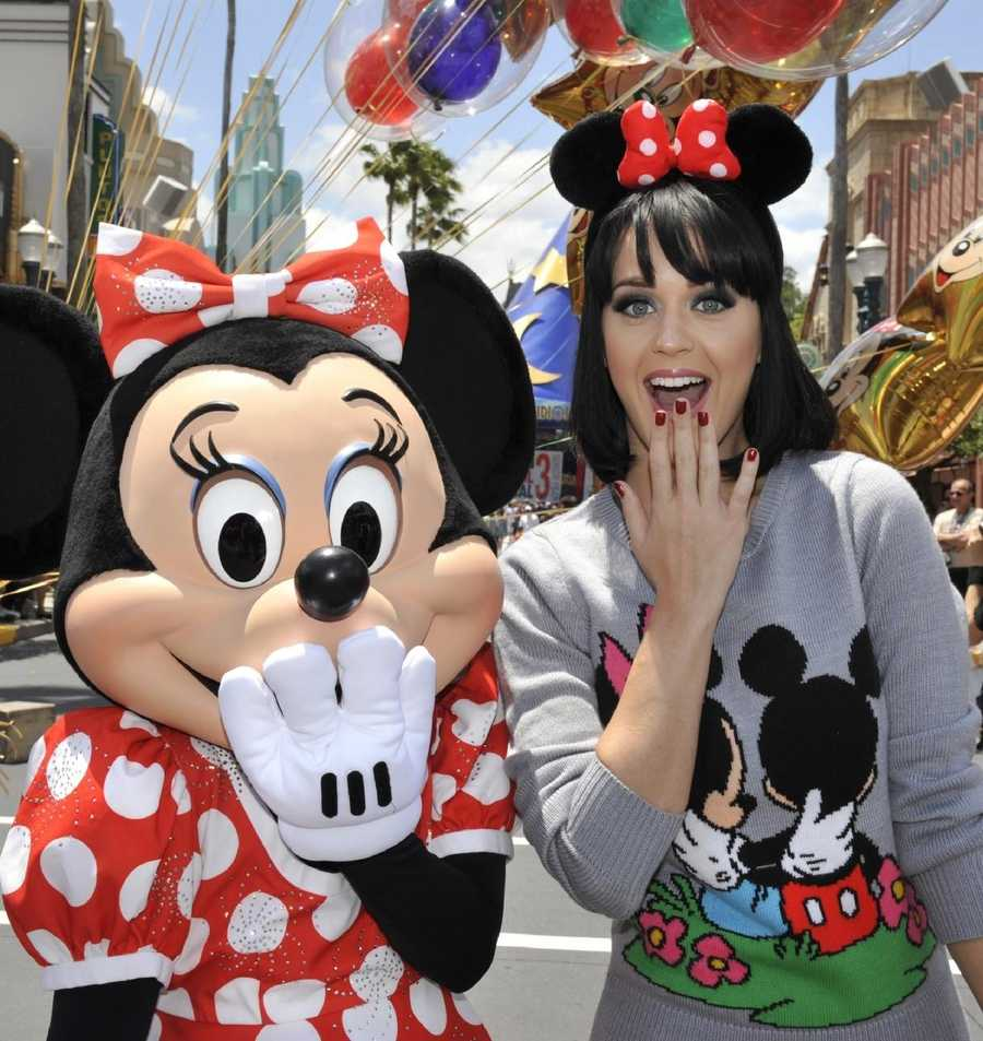 Singer/songwriter Katy Perry poses April 25, 2009 with Minnie Mouse at Disney's Hollywood Studios in Lake Buena Vista, Fla.