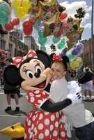 Actress Hayden Panettiere hugs Minnie Mouse April 25, 2009 at Disney's Hollywood Studios in Lake Buena Vista, Fla.