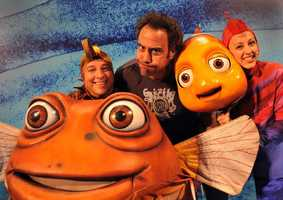 "Comedian Brad Garrett (""Everybody Loves Raymond,"" ""'Til Death"") does his best blowfish impression April 1, 2009 alongside two characters from the ""Finding Nemo - The Musical"" show at Disney's Animal Kingdom in Lake Buena Vista, Fla."