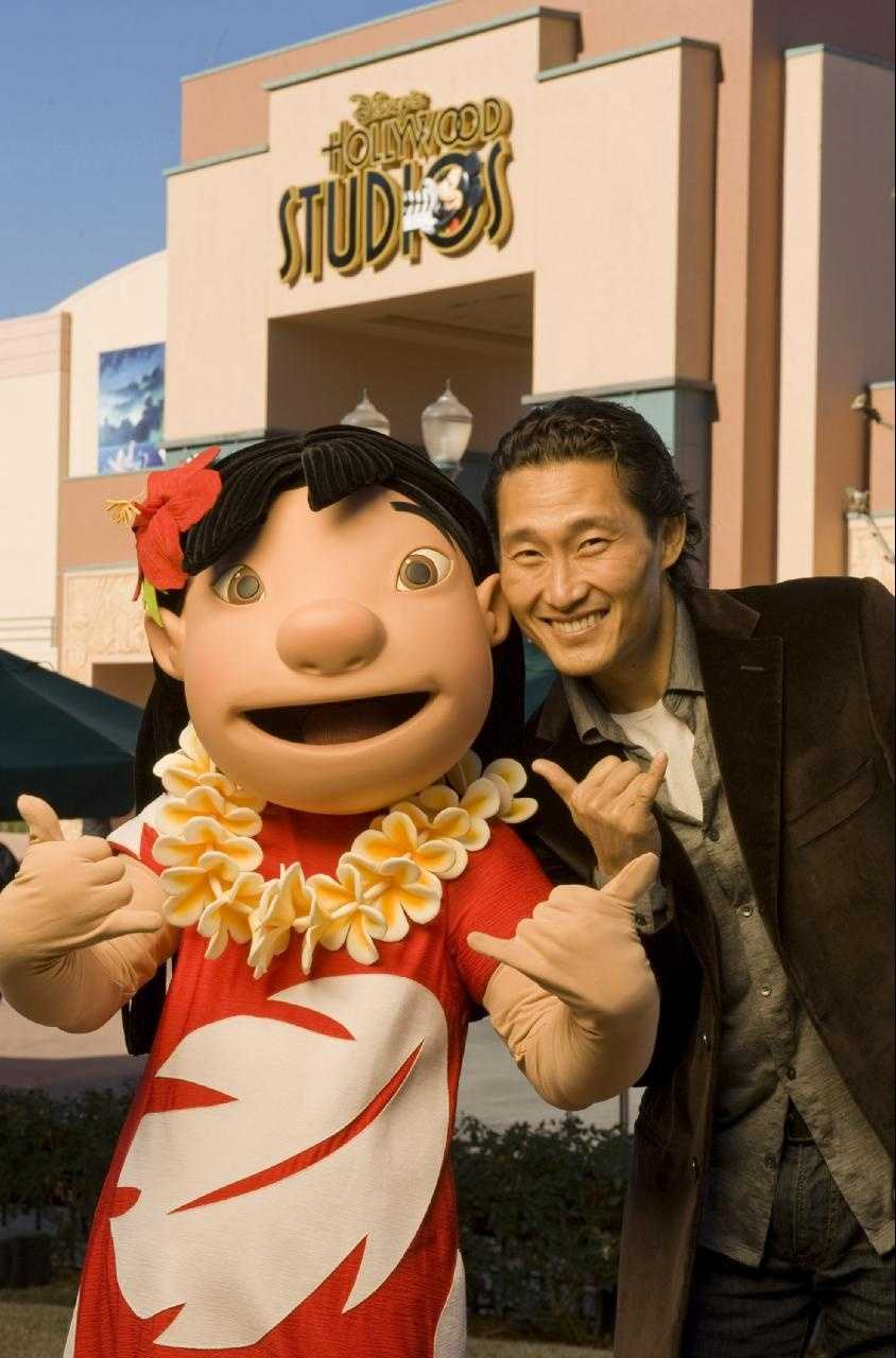 """Actor Daniel Dae Kim, star of the ABC series """"Lost"""" and currently starring on the new CBS series """"Hawaii Five-0,"""" poses Dec. 28, 2010 with Lilo from Disney's animated film """"Lilo and Stitch"""" at Disney's Hollywood Studios in Lake Buena Vista, Fla."""