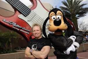 "Aerosmith drummer Joey Kramer poses with Goofy Feb. 25, 2011 at Disney's Hollywood Studios in front of the ""Rock 'n' Roller Coaster Starring Aerosmith,"" the Walt Disney World roller coaster that is named after the band."