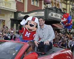 Super Bowl XLV Most Valuable Player Aaron Rodgers takes a celebratory ride with Mickey Mouse Feb. 7, 2011 at Walt Disney World Resort in Lake Buena Vista, Fla.