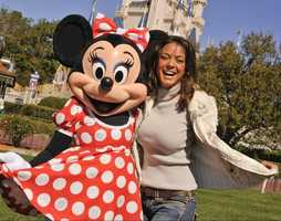 "Actress Eva La Rue, star of the CBS series ""CSI: Miami,"" shares a laugh March 1, 2010 with Minnie Mouse at the Magic Kingdom in Lake Buena Vista, Fla."