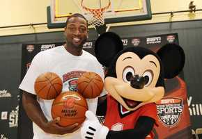 Miami Heat guard Dwyane Wade poses July 11, 2010 with a basketball-clad Mickey Mouse at the ESPN Wide World of Sports complex in Lake Buena Vista, Fla. In honor of Wade's visit to the 220-acre sports facility, Walt Disney World presented him with a custom-made and hand-painted trio of basketballs in the shape of Mickey Mouse's head.