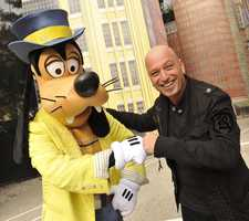 "Comedian Howie Mandel, host of NBC's game show ""Deal or No Deal"" and a judge on the NBC series ""America's Got Talent,"" shares a ""fist-bump"" with Goofy Jan. 1, 2011 at Disney's Hollywood Studios in Lake Buena Vista, Fla."