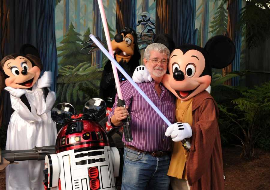 """Star Wars"" creator George Lucas meets Jedi Mickey Mouse, Princess Leia Minnie, Darth Goofy and the lovable Disney droid R2-MK, Aug. 14, 2010 at Disney's Hollywood Studios theme park. The legendary filmmaker attended a special event at the theme park in honor of the ""Star Wars""-themed thrill attraction, Star Tours."