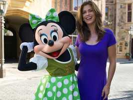 """Supermodel-turned-entrepreneur Kathy Ireland poses March 15, 2012 with a St. Patrick's Day-themed Minnie Mouse in the United Kingdom pavilion at Epcot in Lake Buena Vista, Fla.  Ireland is CEO and chief designer for """"kathy ireland Worldwide,"""" a global design and marketing firm she founded in 1993."""