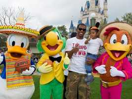 Los Angeles Clippers All-Star guard Chris Paul joins his son, Chris, Feb. 23, 2012 at the Magic Kingdom theme park at Walt Disney World Resort in Lake Buena Vista, Fla.  Paul, who also starred on Team USA's gold medal-winning squad at the 2008 Beijing Olympic Games, is in Orlando, Fla., for the NBA's 2012 All-Star Weekend.  He will be in the starting lineup for the Western Conference All-Stars during NBA All-Star Game.