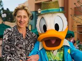 """Emmy Award-winning actress Edie Falco poses Dec. 27, 2011 with Donald Duck at Disney's Hollywood Studios theme park at Walt Disney World in Lake Buena Vista, Fla.  Falco, who won three Emmy Awards for her role as Carmela Soprano on HBO's drama series """"The Sopranos,"""" also won an Emmy Award for her portrayal of Jackie Peyton on the Showtime comedy series, """"Nurse Jackie."""""""