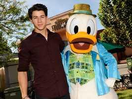 Singer Nick Jonas poses Nov. 9, 2011 with Donald Duck during a visit to Disney's Hollywood Studios theme park at Walt Disney World Resort in Lake Buena Vista, Fla.