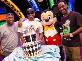 """Boyz II Men members, (L-R), Wanya Morris, Nathan Morris and Shawn Stockman join Mickey Mouse Oct. 24, 2011 on stage at Walt Disney World Resort in Lake Buena Vista, Fla. to commemorate the release of the R&B vocal group's 20th anniversary album, entitled """"TWENTY."""" The celebration took place at Epcot theme park after the group performed at the Epcot International Food & Wine Festival's """"Eat to the Beat"""" concert series."""