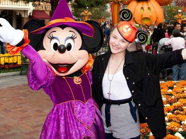 Actress Chloë Moretz celebrates Halloween Time with Minnie Mouse at Disneyland park in Anaheim, California, on Oct. 24.