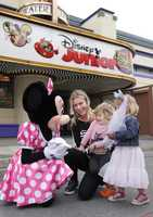 """Rebecca Romijn and twin daughters, Dolly (right) and Charlie meet Minnie Mouse for the first time outside the Disney Junior Live on Stage! show at Disney California Adventure park in Anaheim, Calif., on Friday. A new short-form series featuring Minnie Mouse, """"Minnie's Bow-Toons,"""" premieres Nov. 14 on Disney Junior."""