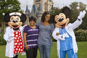 """""""Grey's Anatomy"""" star Chandra Wilson (left) and """"Private Practice"""" star Audra McDonald (right) pose with Nurse Minnie Mouse and Dr. Mickey Mouse June 28, 2011 at the Magic Kingdom park in Lake Buena Vista, Fla.  Wilson portrays Dr. Miranda Bailey on """"Grey's Anatomy"""" and McDonald portrays Dr. Naomi Bennett on """"Private Practice."""""""