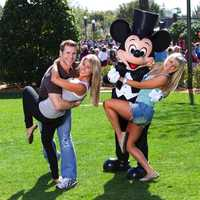 """Jake Pavelka (left), star of ABC's """"The Bachelor,"""" strikes a dance pose March 13, 2010 with his fiancee, Vienna Girardi (second from left) while Mickey Mouse poses with professional dancer Chelsie Hightower (right), star of ABC's """"Dancing with the Stars,"""" at the Magic Kingdom in Lake Buena Vista, Fla."""