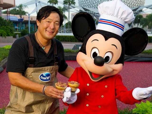 Celebrity chef Ming Tsai cooks up his pumpkin mousse with cranberries and orange sauce with Chef Mickey during the Epcot International Food & Wine Festival at Walt Disney World Resort.  Tsai's demonstration took place at a new Ocean Spray cranberry bog set up as part of the festival.
