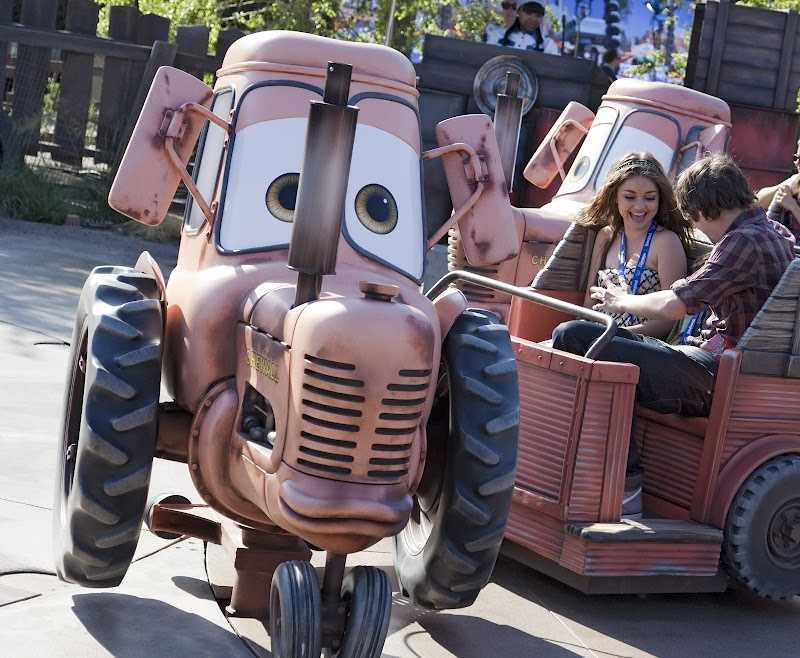 "Modern Family star, Sarah Hyland, takes a spin on the ""Mater's Junkyard Jamboree"" attraction."